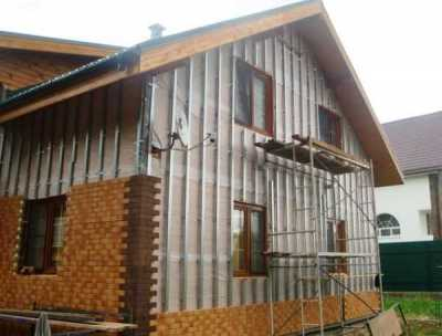 Облицовка дома искусственным камнем и покрытием для фасадов